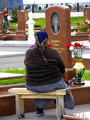 Beslan school siege - A Beslan mother at the cemetery for the siege victims in 2006