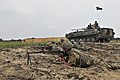 A BMP-2 provides support by fire to Ukrainian infantry during a platoon live-fire.jpg
