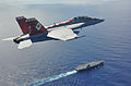 A U.S. Navy F-A-18F Super Hornet aircraft assigned to Strike Fighter Squadron (VFA) 102 flies past the aircraft carrier USS George Washington (CVN 73) in the Philippine Sea Aug. 21, 2013 130821-N-ZZ999-0047.jpg