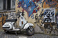 A Vespa scooter covered with Graffitt, Rome - 3489.jpg