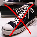 A classic Black pair of Converse All Stars resting on the Black & White Ed. Shoebox (1998-2002) 2.JPG