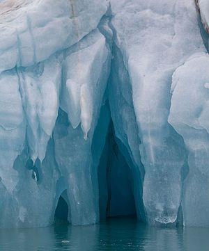 Capsizing Iceberg showing large cavities underneath