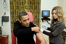 A nurse vaccinates Barack Obama against H1N1