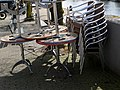 A still life photo of piles of terrace chairs and tables along Entrepotdok canal; Amsterdam center 2013.jpg