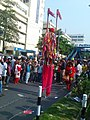 A stilt walker at Shahbag , Dhaka .jpg
