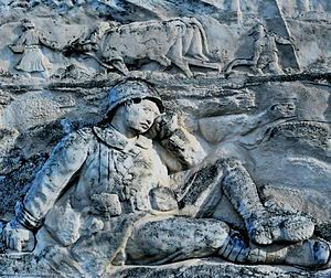 André Abbal - Abbal relief on Saint-Nicolas-de-la-Grave War Memorial.  A soldier dreams of his farm and homeland