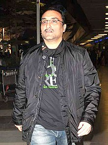 Aditya Chopra returns from vacation.jpg