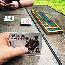 Afternoon cribbage on the patio. (50002851016).jpg