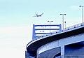 Airliner flying over tokyo gate bridge in Tokyo Bay.jpg