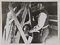 Akseli Gallen-Kallela with a worker at Tarvaspää planning the repairing of the building, 1929. (14542287608).jpg