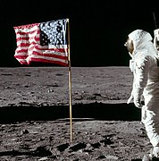 Cropped Photo Of Buzz Aldrin Saluting The Flag Fingers Aldrins Right Hand Can Be Seen Behind His Helmet