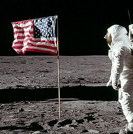 Cropped photo of Buzz Aldrin saluting the flag (Note the fingers of Aldrin's right hand can be seen behind his helmet).