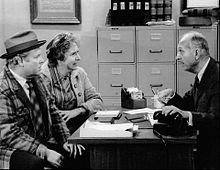 Stapleton with Carroll O'Connor (left) and guest star James O'Rear, in a 1973 episode of All in the Family
