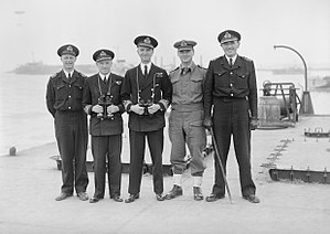 William Tennant (Royal Navy officer) - Rear Admiral Tennant (center) with his officers on Mulberry B, Arromanches, July 1944