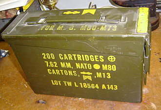 Ammunition box - An M19A1 ammunition box for 7.62×51mm NATO M80 Ball cartridges. It is linked Machinegun ammunition packed in 100-round cartons and carried in cloth bandoleers.