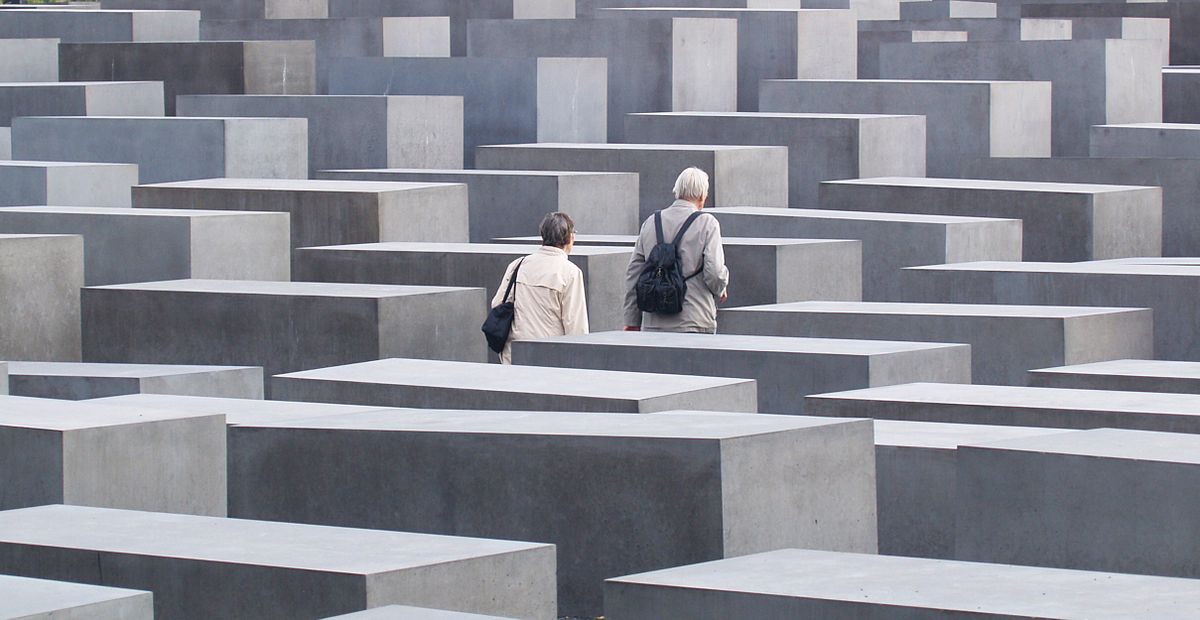 An elderly couple walking in the Memorial to the Murdered Jews of Europe, Berlin.jpg