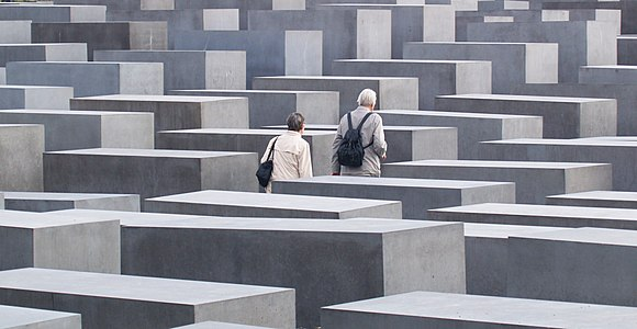 Memorial to the Murdered Jews of Europe, Berlin, 2008 An elderly couple walking in the Memorial to the Murdered Jews of Europe, Berlin.jpg