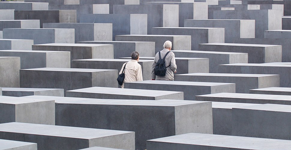 An elderly couple walking in the Memorial to the Murdered Jews of Europe, Berlin