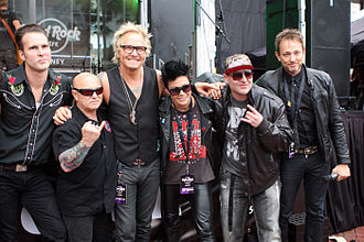 Angry Anderson - Left to right: Hamish Rosser, Anderson, Matt Sorum, Sarah McLeod, DJ Lethal at opening of Darling Harbour's Hard Rock Cafe in December 2011.