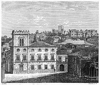 Palace of the Dukes of Braganza - The Terreiro da Misericórdia, showing the shadowy figure of the Palace in the background (right)