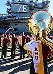 Arizona State University marching band performs in front of USS Ronald Reagan 131229-N-AV746-602.jpg