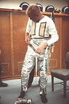 Astronaut John H. Glenn Jr. dons space suit during pre-flight operations at Cape Canaveral.jpg