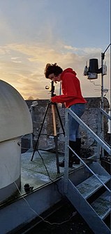 Astronomer observing the transit of Mercury.jpg