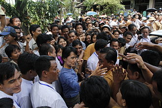 "Civil resistance - Aung San Suu Kyi, Burmese pro-democracy leader, greeting supporters from Bago State, Burma, 14 August 2011. She has stated that she was attracted to non-violent civil resistance, not on moral grounds, but ""on practical political grounds"". Photo: Htoo Tay Zar"