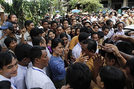 "Aung San Suu Kyi, Burmese pro-democracy leader, greeting supporters from Bago State, Burma, 14 August 2011. She has stated that she was attracted to non-violent civil resistance, not on moral grounds, but ""on practical political grounds"". Photo: Htoo Tay Zar Aung San Suu Kyi greeting supporters from Bago State.jpg"