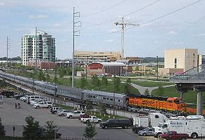 Economy of Omaha, Nebraska - The BNSF passenger train visits the Omaha Riverfront for the annual Berkshire Hathaway shareholder convention at the CenturyLink Center Omaha.