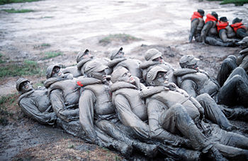 Image of BUD/S trainees covered in mud during ...