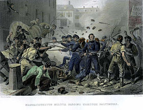 A color sketch depicting a riot in an urban setting. In the center of the scene is a small group of soldiers wearing blue uniforms and carrying muskets with fixed bayonets, the mob attacking the soldiers carries bats, pick axes and other weapons. Bricks and debris are flying in the air.