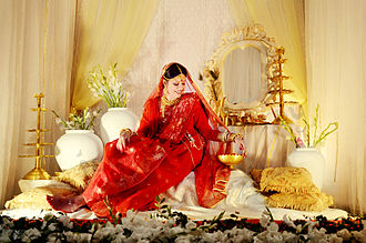Jamdani Sari of Bangladesh is very popular in West Bengal. Bangladeshi bride in Jamdani sari.jpg
