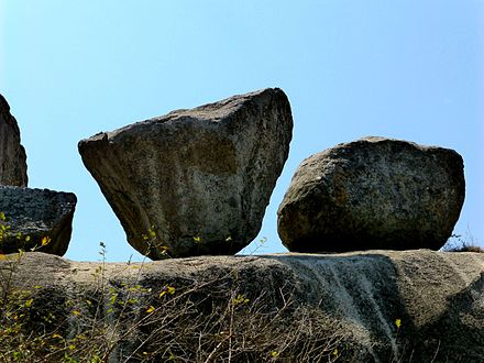 Barabar Caves - Balanced Rock (9224652741).jpg