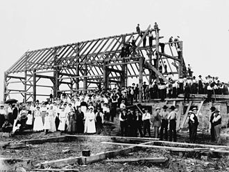 Barn raising - A barn raising north of Toronto, Ontario, Canada in the 20th century