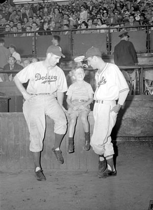 Jean-Pierre Roy - A young fan between Hugh Casey (left) and Jean-Pierre Roy (right) in Delorimier Stadium, Montreal, 6 July 1946.