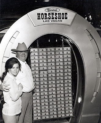 Benny Binion - Benny Binion with his youngest daughter Becky (eventual owner of Binion's Horseshoe) in front of the famous $1 million display (c. 1969).