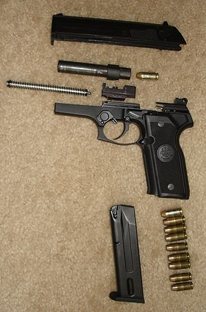 Beretta 8000 - Beretta 8040 Cougar Pistol disassembled to show parts.