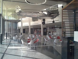 Toowoomba Wellcamp Airport - QantasLink check in counter, cafe and Southern Cross SC-1 prototype on display.
