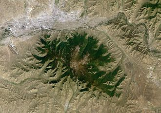 Bogd Khan Mountain - A satellite image, showing Bogd Khan Mountain in the center, Ulaanbaatar in the northwest corner, Tuul River running between the city and the mountain, the town of Zuunmod south of the mountain, the town of Nalaikh east of the mountain, and Chinggis Khaan International Airport west of the mountain