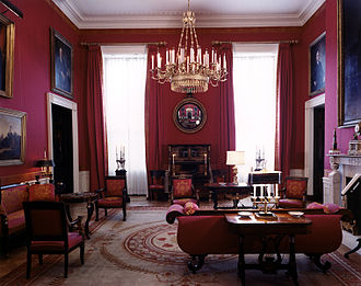 Maison Jansen - The White House Red Room as designed by Stéphane Boudin during the administration of John F. Kennedy. Boudin furnished the room primarily in the American Empire style with many pieces by the cabinetmaker Charles-Honoré Lannuier. Decorative tapes for the Napoleonic campaign style drapes were woven by the firm Tassinari et Chatel.