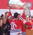 Brandon Saad hoists the Stanley Cup (9161754807).jpg