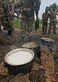 Bujumbura Burundi soldiers cooking sufuria crop.jpg
