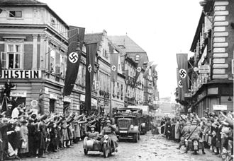 German occupation of Czechoslovakia - Ethnic Germans in Saaz, Sudetenland, greet German soldiers with the Nazi salute, 1938