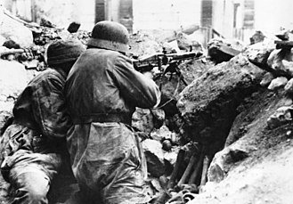 MG 42 - Well-entrenched Fallschirmjäger defend the ruins of Monte Cassino, inflicting heavy casualties on assaulting Allied forces