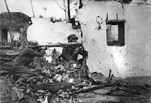 Panzerschreck - Soldiers of the German Großdeutschland division's Panzerfüsilier regiment prepare an ambush in the ruins of a destroyed building on the Eastern Front, 1944.
