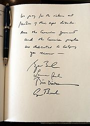 "A note signed by former United States Presidents George H. W. Bush and Bill Clinton, First Lady Laura Bush, and President George W. Bush expressing their condolences during a visit to the embassy of Sri Lanka in Washington, D.C., Monday, January 3, 2005. The President wrote, ""We pray for the victims and families of this epic disaster. And the American government and American people are dedicated to helping you recover."""