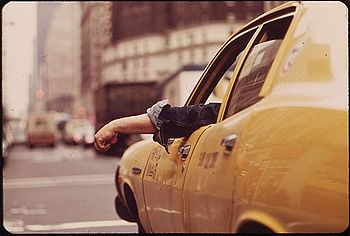 CAB DRIVER WAITS AT INTERSECTION IN MIDTOWN - ...