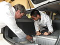 CSIRO ScienceImage 11473 CSIRO engineers refitting a plugin hybrid electric trial car with a larger battery pack and battery charger which can plug into a standard household power point or a special charging point.jpg