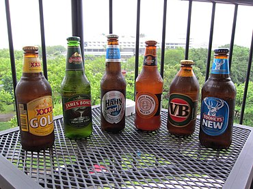 Six Australian beers. XXXX Gold was Australia's top-selling beer by volume in 2012. Cairns Australia Beer Run.jpg